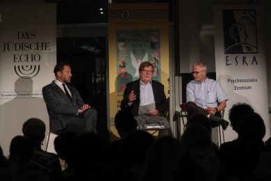 Three men in a panel discussion